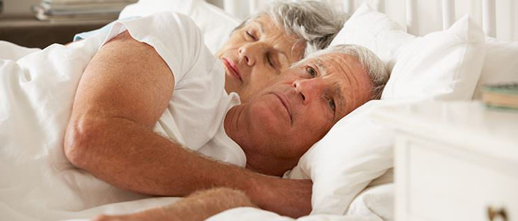 older couple laying in bed